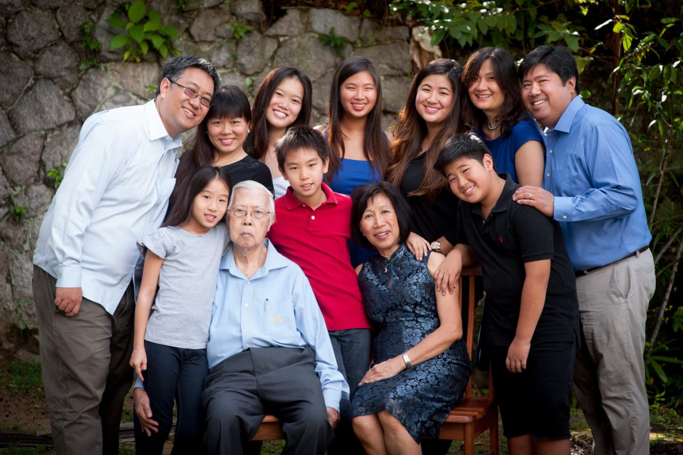 Canon James Wong and family. Canon James Wong (first row, second from left). Timothy Wong (second row, leftmost).